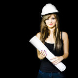 Graduate engineer holding construction design plan Royalty Free Stock Photo
