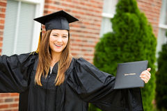 Graduate: Female Graduate Cheering WIth Diploma Stock Photography