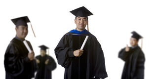 Graduate in front of Blurry Graduates Royalty Free Stock Photo