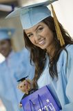 Graduate with Gift Bag outside portrait Stock Photos