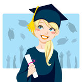 Graduate Girl. Young blond woman smiling celebrating graduation day holding diploma in her hand Royalty Free Stock Photography