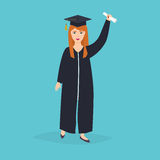 Graduate girl in the mantle keeps in hands graduation diploma. U Royalty Free Stock Image