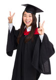 Graduate girl student showing victory sign Stock Images