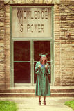 Graduate giving thumbs up with vintage effects Stock Photography