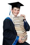 Graduate in gown with books Stock Photography