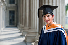 Graduate In Hallway Stock Photo