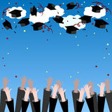 Graduate Hands Throwing Up Graduation Hats. Graduation Background with Place for Text. Graduation Caps in the Air. Royalty Free Stock Images