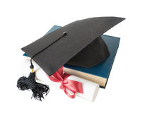 Graduate hat, book and scroll Royalty Free Stock Photos