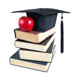 Graduate hat, books and  apple Stock Photography