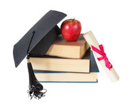 Graduate hat, books, apple and scroll Royalty Free Stock Photo