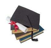 Graduate hat, books and scroll Royalty Free Stock Images