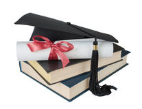 Graduate hat, books and scroll Royalty Free Stock Photos