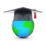 Graduate hat and globe Stock Image
