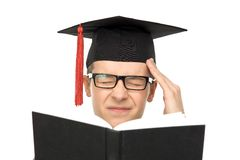 Graduate with a headache Stock Images