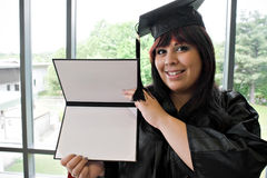 Graduate with Her Diploma Stock Image