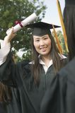 Graduate hoisting Diploma Royalty Free Stock Images