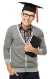 Graduate holding book Stock Images