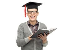 Graduate holding book Royalty Free Stock Photos