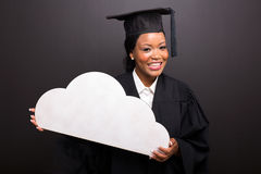 Graduate holding cloud shape Royalty Free Stock Photography