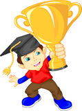 Graduate holding gold trophy Royalty Free Stock Image