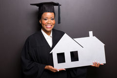 Graduate holding home symbol Stock Photography