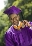 Graduate Holding Medal outside portrait Royalty Free Stock Image