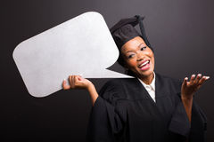 Graduate holding speech bubble Stock Photos