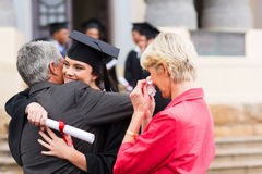 Graduate hugging father Stock Photos