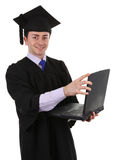 Graduate with laptop Royalty Free Stock Photo