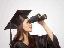 Graduate looking through Binocular Royalty Free Stock Image