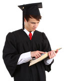 Graduate looking at a book Stock Photo