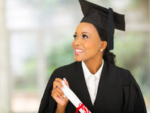 Graduate looking up Royalty Free Stock Photography
