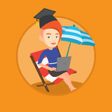 Graduate lying in chaise lounge with laptop. Royalty Free Stock Image