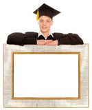 Graduate man with frame Stock Photos