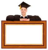 Graduate man with frame Stock Images