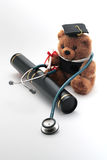 Graduate in Medical School. Scroll, Stethoscope and Graduation Bear Royalty Free Stock Images