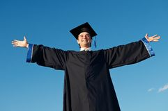 Graduate with open arms outdoors Royalty Free Stock Photos