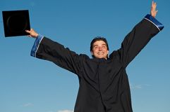 Graduate with open arms outdoors Royalty Free Stock Image