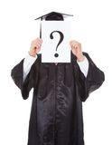 Graduate person holding question mark sign Stock Image