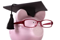 Graduate Piggy Bank student graduation, education savings concept, close up Royalty Free Stock Photography