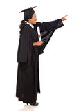 Graduate pointing empty space Royalty Free Stock Photo