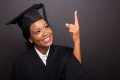 Graduate pointing up Royalty Free Stock Images