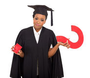 Graduate with question mark Royalty Free Stock Photo