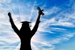 Graduate raised his hands to sky and holds diploma Stock Photo