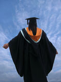 Graduate raising arms Stock Images