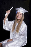 Graduate Raising Diploma In The Air Stock Photos