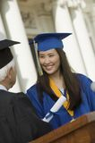 Graduate Receiving Diploma outside university Stock Photos