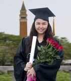 Graduate with Roses Royalty Free Stock Image