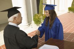 Graduate Shaking Hand With Dean Royalty Free Stock Images