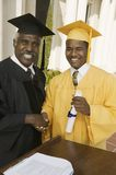 Graduate shaking hand of dean at podium Stock Image
